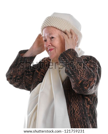 Portrait of old woman wearing hat on white background - stock photo