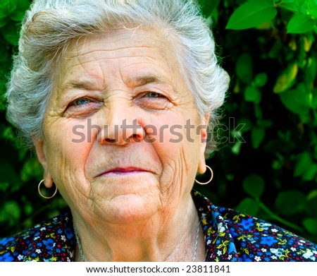 Portrait of old woman with genuine smile - stock photo