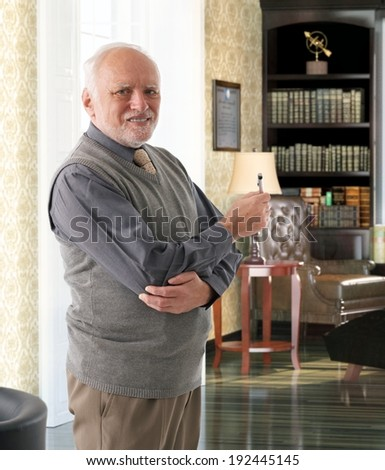 Portrait of older man at library room. - stock photo
