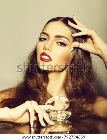 Portrait of one glamour fashionable sensual pretty young stylish woman with beautiful curly long hair and bright red lips and makeup with luxurious glassy decorative shell with pearl, vertical picture