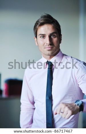 portrait of one young business man at bright office indoor - stock photo
