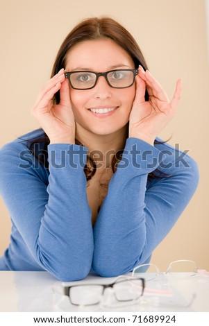Portrait of optician client choose prescription glasses - stock photo