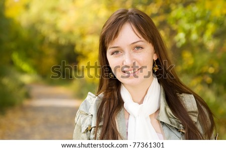 portrait of   ordinary girl  outdoor in autumn - stock photo