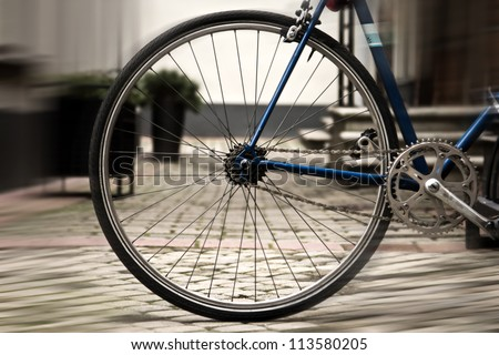 Portrait of os bicycle in the town - stock photo