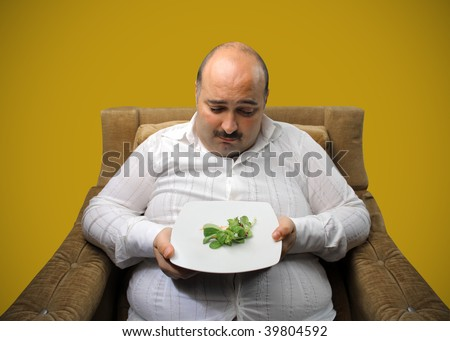 portrait of overweight man on diet - stock photo