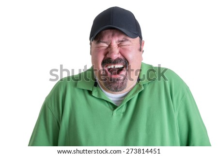 Portrait of Overweight Man Wearing Green Shirt and Black Baseball Cap Laughing Ecstatically in front of White Background, Head and Shoulders Portrait of Joyful Man - stock photo