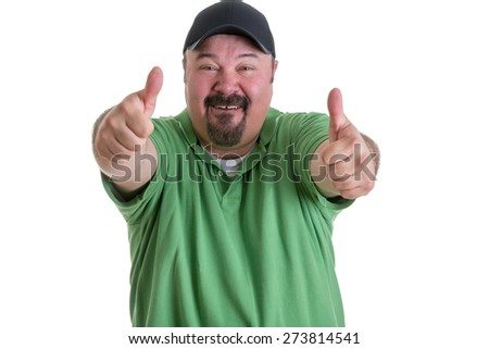 Portrait of Overweight Man with Goatee Wearing Green Shirt and Black Baseball Cap Smiling and Giving Thumbs Up Hand Gesture Toward Camera, on White Background - stock photo