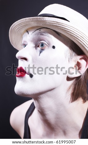 Portrait of pantomime actor with makeup on black background close up