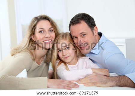 Portrait of parents and daughter - stock photo