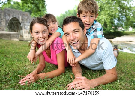 Portrait of parents with kids on their back - stock photo