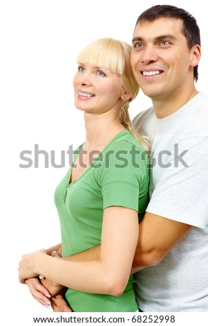 Portrait of passionate man hugging his girlfriend and looking up together