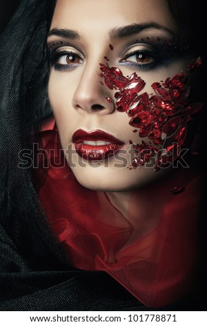 portrait of passionate woman with red gemstones