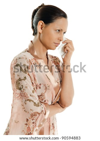 Portrait of pensive Asian woman crying and looking away in studio isolated on white background - stock photo