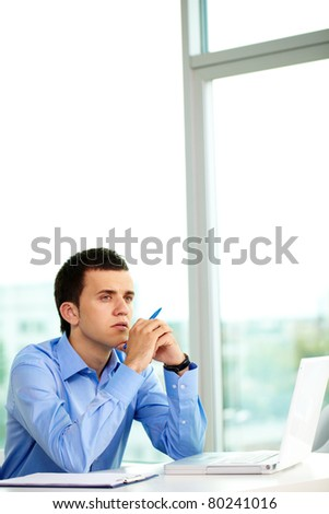 Portrait of pensive businessman thinking of ideas in office - stock photo