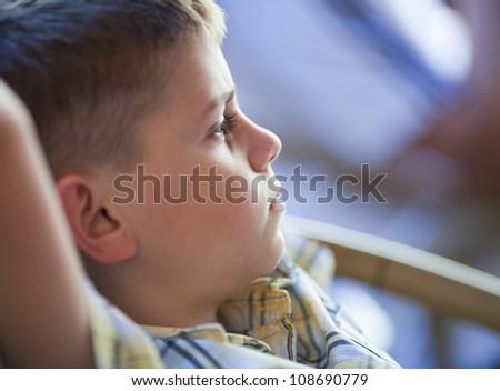Portrait of pensive little boy - stock photo