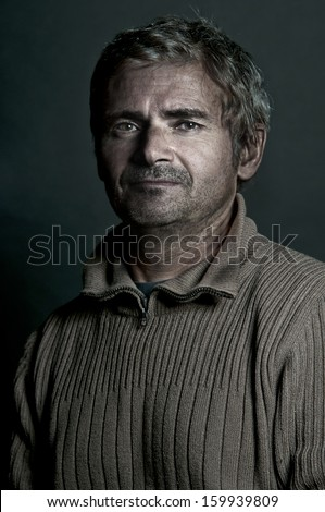 Portrait of pensive man - stock photo