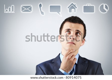 Portrait of pensive man thinking of what to do first - stock photo