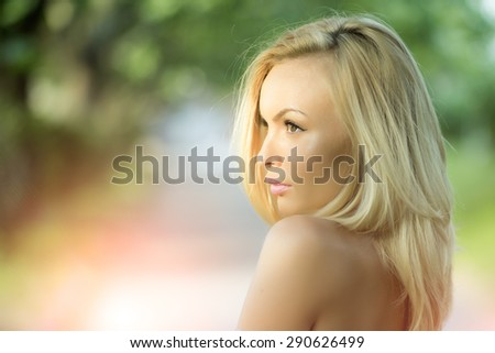 Portrait of pensive pretty blond girl outdoor in summer daylight on natural background copyspace, horizontal picture - stock photo
