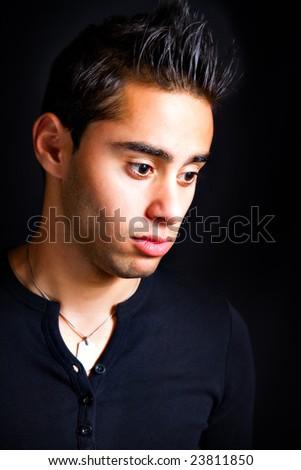 Portrait of pensive sad hispanic man - stock photo
