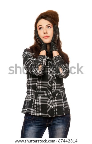 Portrait of pensive young woman in a checkered  jacket