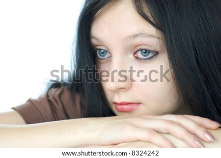 Portrait of pensive young woman with blue eyes looking away isolated on white - stock photo