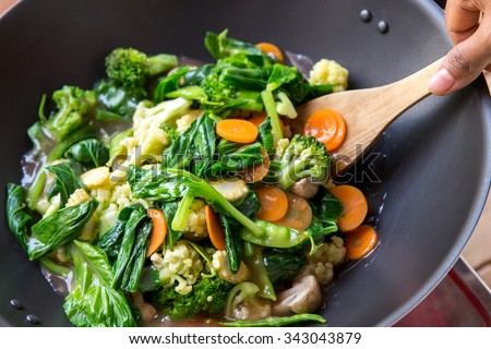 portrait of people cooking healthy vegetarian chinese food capcay