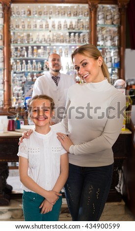 portrait of  pharmacist standing with a cash desk in the pharmacy and helping customers