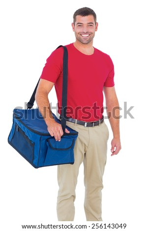 Portrait of pizza delivery man holding bag on white background - stock photo