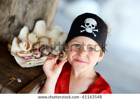 Portrait of playful boy dressed as pirate - stock photo