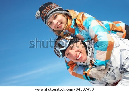 Portrait of playful  couple have a good time in winter - stock photo