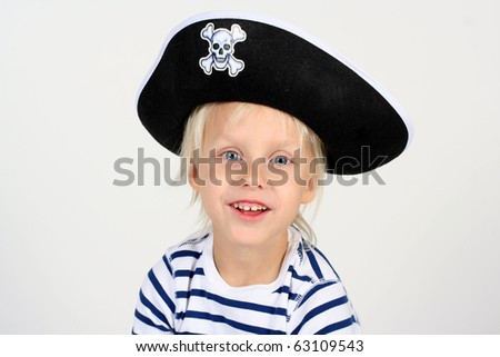 Portrait of playful cute boy dressed as pirate - stock photo
