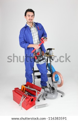 portrait of plumber with tools - stock photo
