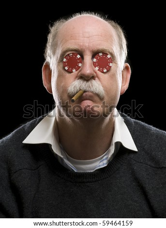 Portrait of poker player with chips in his eyes and cigar in his mouth - stock photo
