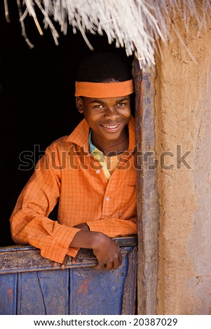 Portrait of poor African child with orange shirt - stock photo