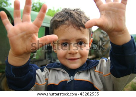 Portrait of poor young boy - stock photo
