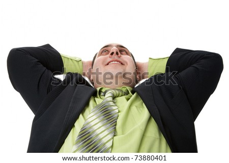 Portrait of positive man with hands behind head - stock photo