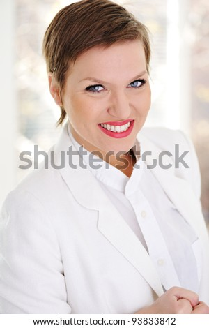 Portrait of positive young business woman smiling - stock photo