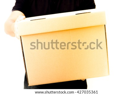 Portrait of postman delivery with some packages and letters - stock photo