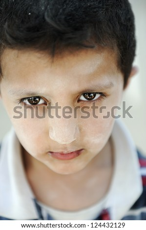Portrait of poverty, little poor dirty boy, closeup - stock photo