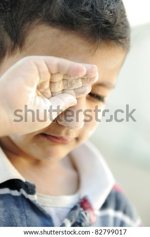 Portrait of poverty, little poor dirty boy, crying - stock photo