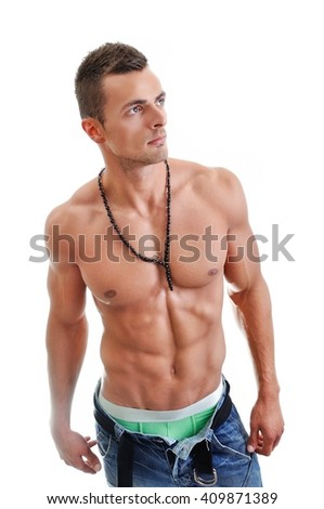 Portrait of Powerful Muscular Man Posing on a White Background