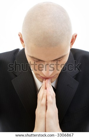 portrait of praying man in black suit over white