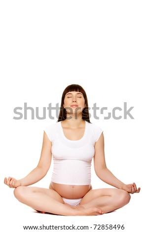 Portrait of pregnant female meditating over white background - stock photo
