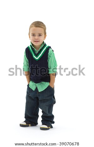 Portrait of preschoold boy posing green shirt and jeans, isolated on white. - stock photo