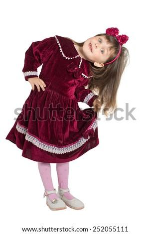 Portrait of preschooler girl in velvet dress. Charming child posing on white background indoors. Studio shot. Isolate on white - stock photo