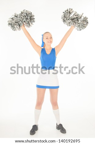 portrait of pretty active young cheerleader - stock photo