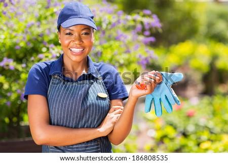 portrait of pretty african american female gardener  - stock photo