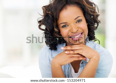 portrait of pretty african woman relaxing at home