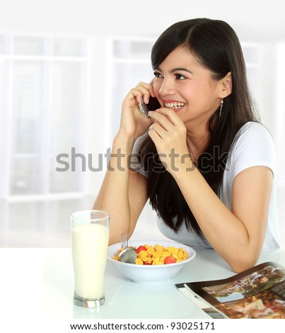 portrait of Pretty asian woman having a glass of tea for breakfast - stock photo