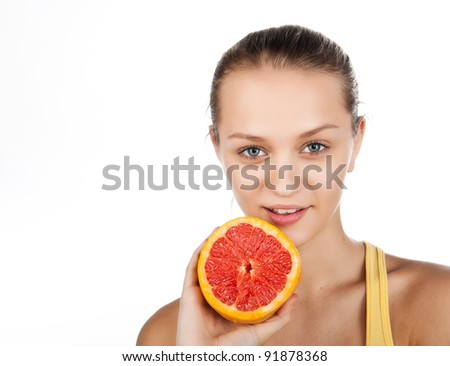 portrait of pretty attractive young woman holding fresh grapefruit, isolated on white background, attractive beauty girl with fruit